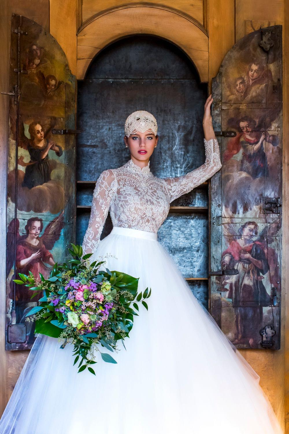 high class bride with flowers in a castle